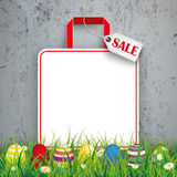 Colored Easter Eggs Grass Shopping Bag Sale Concrete. Green grass with colored easter eggs and shopping bag on the concrete background Stock Photo