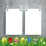 Colored Easter Eggs Grass 2 White Boards Concrete. Green grass with colored easter eggs and white boards on the concrete background Stock Image