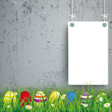 Colored Easter Eggs Grass 2 White Boards Concrete. Green grass with colored easter eggs and white boards on the concrete background Royalty Free Stock Photo