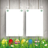 Colored Easter Eggs Grass 2 White Boards. Green grass with colored easter eggs and white boards on the wooden background Royalty Free Stock Photos