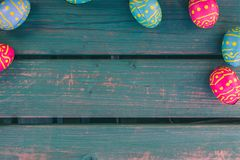 Easter choclate eggs, green bench, easter background royalty free stock images