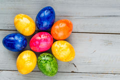 Colored Easter eggs on grey wooden background Royalty Free Stock Photos
