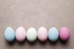 Colored Easter eggs on grunge background stock image