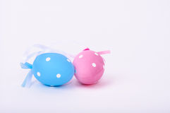 Little blue and pink easter eggs together and isolated on white. Stock Photo