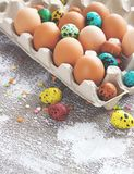 Colored easter eggs on a light canvas background,place for text Royalty Free Stock Photo