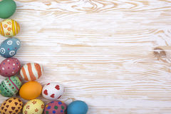 Colored Easter eggs. Colored Easter eggs on light wooden background royalty free stock image