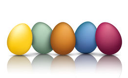 5 Colored Easter Eggs Mirror. 5 colored easter eggs on the mirror Stock Photography