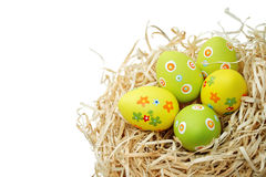 Colored Easter eggs into a nest Stock Photos