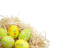 Colored Easter eggs into a nest Stock Image