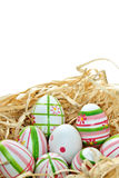 Colored Easter eggs into a nest Stock Photography