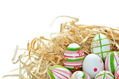 Colored Easter eggs into a nest Royalty Free Stock Photos