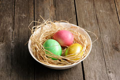 Colored easter eggs in nest Royalty Free Stock Photo