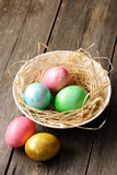 Colored easter eggs in nest Stock Images