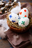 Colored Easter eggs in a nest Royalty Free Stock Photography