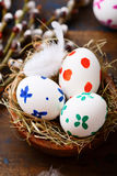 Colored Easter eggs in nest Royalty Free Stock Photos