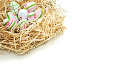 Colored Easter eggs into a nest from top corner Stock Photo