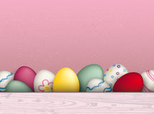 Colored Easter Eggs Pink Background. Colored easter eggs on the pink background Royalty Free Stock Photo