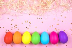 Colored Easter eggs on pink background. Flatlay. stock images