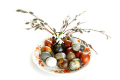 Colored easter eggs on plate with pussy willow and lily of valle Royalty Free Stock Image