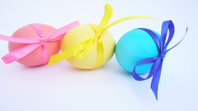 Colored Easter eggs with ribbons stock video