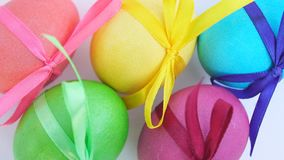 Colored Easter eggs with ribbons stock footage