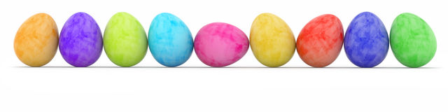 Colored easter eggs in a row. Row of easter eggs painted in watercolor Stock Photography