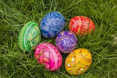 Colored Easter Eggs. Six Easter Eggs in grass royalty free stock photo