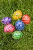 Colored Easter Eggs. Some Colored Easter Eggs in Grass Royalty Free Stock Photos