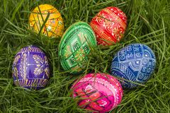 Colored Easter Eggs. Some Colored Easter Eggs in Grass Stock Photography