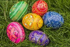 Colored Easter Eggs. Some Colored Easter Eggs in Grass Stock Image