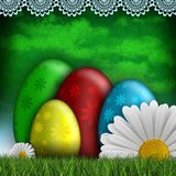 Colored Easter eggs and spring flowers Stock Photos