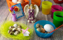 Colored Easter eggs table decoration with angel Royalty Free Stock Images
