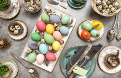 Colored Easter eggs table decoration Royalty Free Stock Image