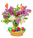 Colored easter eggs and a transparent vase with the flowers Stock Images