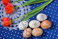 Colored Easter Eggs with Tulips Stock Photo