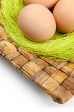 Colored Easter eggs are on wattled plate Stock Photo