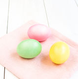 Colored Easter eggs on white wooden background Royalty Free Stock Images