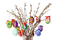 Colored easter eggs on willow bouquet over white Stock Photo