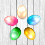 Colored Easter eggs on wooden background Royalty Free Stock Photo