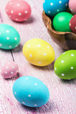 Colored Easter eggs on wooden background Royalty Free Stock Photos
