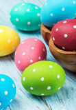 Colored Easter eggs on wooden background Stock Image