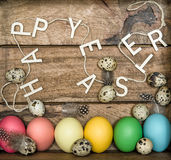 Colored easter eggs on wooden background. Happy Easter Royalty Free Stock Image