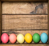 Colored easter eggs on wooden background Royalty Free Stock Images