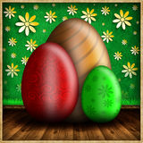 Colored Easter eggs on wooden floor Stock Image
