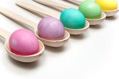 Colored easter eggs and wooden spoons   on white Stock Images