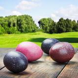 Colored Easter eggs on a wooden table Stock Image