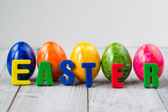Colored Easter eggs and word easter made of magnet letters Stock Image