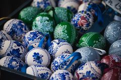 Colored Easter wooden eggs fullframe. Blue and green Stock Image