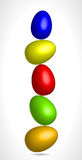 Colored eggs balancing in equilibrium. Abstract Royalty Free Stock Images