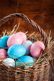 Colored Eggs in the Basket Stock Photography